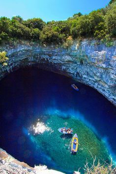 """On the eastern side of the island of Kefalonia in Greece there is a sunken lake call Melissani Cave. Also, known as the """"Cave of the Nymphs"""". Train Tracks, Luxury Travel, The Good Place, Around The Worlds, Adventure, Nature, Pictures, Outdoor, Beautiful"""