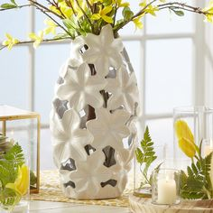 Gavin Ceramic Vase | Featuring a detailed floral design in crisp white ceramic, this unique vase is perfect for displaying a colorful bouquet of flowers.