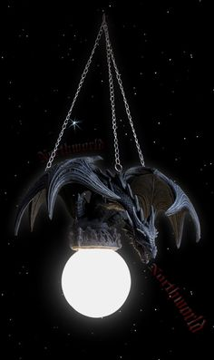 Dragon ceiling light... I would definetly have in an at home office ^_^ or art room
