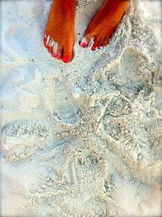 Barefoot in white sand
