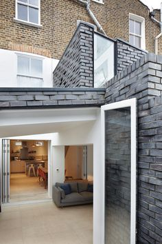 Fraher Architects includes textured brick cladding on north London house extension.