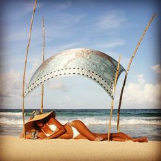 """""""Lying on the beach in a #PinkHouseMustique bikini under a #LottyB #sarong. Heaven."""""""