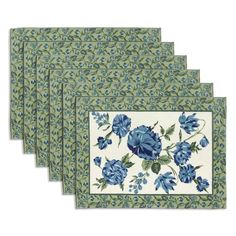 """Cherish your """"tea and biscuits"""" experience with these floral tea mats. It is a set of 6 mats. They are made of 100% cotton fabric. They have fern green borders with floral patterns made over it. Additionally, there are floral designs in shades of green and blue over off-white background in the main body of the mats. They look graceful and this will brighten you and your friends up whenever you are having your little tea party or even a tea break. They are washable and the colors do not…"""