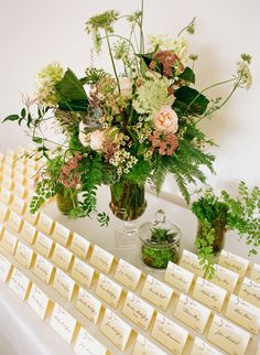 Textured Fern and Wildflower Escort Card Table | Epitome Papers https://www.theknot.com/marketplace/epitome-papers-edina-mn-549668 | Martha's Gardens | Liz Banfield Photography https://www.theknot.com/marketplace/liz-banfield-photography-minneapolis-mn-306799