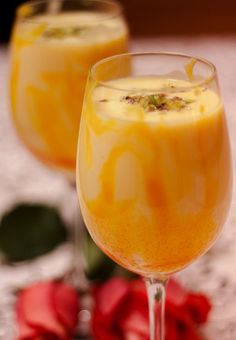 Mango Lassi is an Indian mixed drink that often used to mitigate spicy meals. My son LOVES mango lassi Dessert Drinks, Fun Drinks, Healthy Drinks, Beverages, Mixed Drinks, Healthy Snacks, Smoothies, Smoothie Drinks, Juice Smoothie