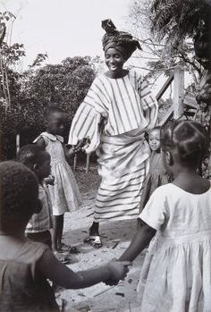 Nigeria, Modern King: Wife no. 1 of the King of Akure, Mrs. Adesida plays with little girls at a kindergarten she helped organize for children of working mothers in Akure. (20th Century) Artist: Marc Bernheim ; Evelyne Bernheim
