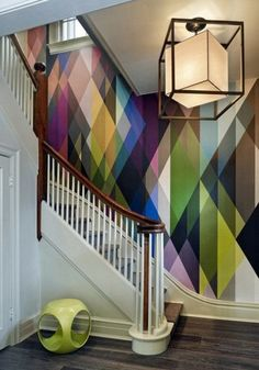 Choose a colorful graphic wallpaper to totally transform an entrance way in your dream home.