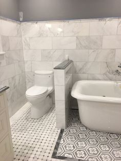 """A  bathroom with a difference. A Venato Carrara and Bardiglio Grey marble mosaic surrounded by matching Venaro Carrara 12 x 24"""" tiled walls, offset by our gorgeous Luxe Flower Hexagon Waterjet mosaic  https://tilebuys.com/products/carrara-white-marble-octagon-mosaic-tile-bathroom-floor-kitchen-backsplash https://tilebuys.com/products/carrara-white-marble-octagon-mosaic-tile-bathroom-floor-kitchen-backsplash #tilebuys  #tilebuys2017 #carrara #carraramarble #venatocarrara #venatomarble…"""