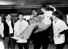 American heavyweight boxer Cassius Clay (later Muhammad Ali) in a boxing ring with the Beatles at the 5th Street Gym, Miami, during the run-up to his title fight against Sonny Liston, 18th February 1964.