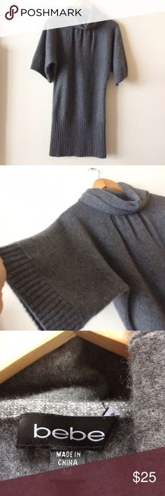 Bebe Cashmere Sweater Great used condition, had a small hole next to swam that has been repaired, not noticeable now. Super soft and cozy bebe Sweaters