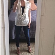 Express Sleeveless Top Cowlneck tank top with grey rivet detail on shoulders. I'm wearing a black tank top underneath. It is more of a cream color. You can wear it with jeans or even leggings. Very soft fabric! Size small Tops Tank Tops