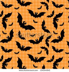 A seamless pattern of bats flying through the air on transparent background