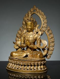 BODHISATTVA IN FRONT OF A DOUBLE NIMBUS Catalog Number: AB916-238 Bronze with fire gilding Nepal 19th cent. HEIGHT 42 CM