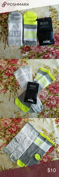 VS PINK Crew Socks  Two Pair Victoria's Secret Pink collection.  Two pair of logo crew socks. 1. Pale gray and white with leopard design 2. Dark grey white and fluorescent yellow. One size PINK Victoria's Secret Accessories Hosiery & Socks