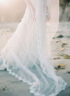 bridal veil | ethereal beach wedding inspiration | luminous photography | Wedding Sparrow