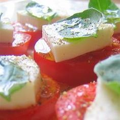 Ingredients Serves: 6  4 large ripe tomatoes, sliced 500g fresh mozzarella balls, sliced handful fresh basil leaves 2 tablespoons extra virgin olive oil fine sea salt to taste freshly ground black pepper to taste Directions Prep:15min  ›  Ready in:15min  On a large platter, alternate and overlap the tomato slices, mozzarella slices and basil leaves. Drizzle with olive oil. Season with sea salt and pepper.