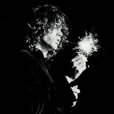 Jim onstage with a sparkler