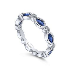 An Alternating Diamond And Sapphire Motif Garnishes. This Stackable Ring Ideal For September Birthdays. White Gold Marquise Sapphire and Round Diamond Ring Surrey Vancouver Canada Langley Burnaby Richmond