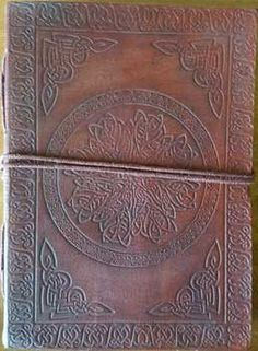 This Celtic Mandela leather blank book is centered with a tooled embossed encircled Mandela, bordered with Celtic design tooling. The back cover has a beautiful embossed pattern, it's spine edge has a