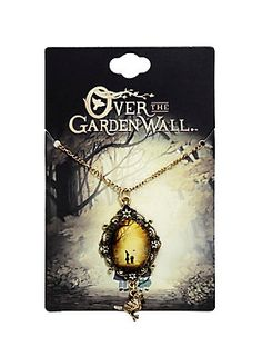 """Journey into the Unknown with this gold tone necklace from <i>Over the Garden Wall</i> featuring a cameo pendant with image of Wirt and Greg and a dangling Beatrice charm. <br><ul><li style=""""list-style-position: inside !important; list-style-type: disc !important"""">Chain: 24"""" long with 3"""" extender</li><li style=""""list-style-position: inside !important; list-style-type: disc !important"""">Pendant: 1"""" x 2""""</li><li style=""""list-style-position: inside !important; list-style-type: disc…"""