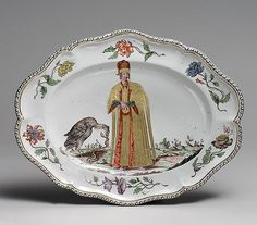 "ca. 1745 Italian; Doccia Hard-paste porcelain.This platter, on display at the Met Museum, was produced in the Italian porcelain factory founded by Carlo Ginori  at Doccia, near Florence in 1737. The painting is of a Turkish man copied from a painting by Jacopo Ligozz from his works in ""Navigation and Voyages in Turkey"", first published in 1576. Bold colors and the large floral paintings on the platter reflect the time period."