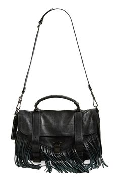 Going boho-chic with swingy, retro-inspired fringe on this gorgeous leather satchel that can easily be dressed up or dressed down depending on the occasion.
