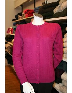 100% Fine Merino Wool lumbar cardigan from Castle of Ireland Knitwear. Featuring a Baby Cable design.