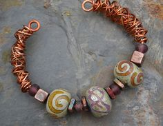 Cool wire wrap.  Looks pretty simple to do.