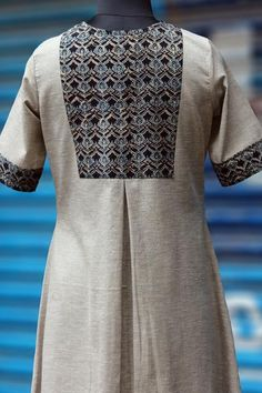 a shirt dress with coconut buttons and ajrakh yoke at the back! the main fabric is 100% cotton flex fabric with a texture of khadi + linen the yoke fabric is