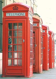 England:  #England ~ Classic red telephone boxes.