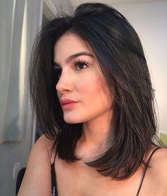 Rich and Dark with long layers on medium length hair cut