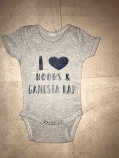 Boobs & Gangsta Rap are in right now!!! Come get your baby onesie fix at www.trendingtrudy.etsy.com