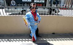 """Tiny Elvis  Barely bigger than the toddler he poses with for a picture, Las Vegas' Tiny Elvis is committed to staying in character.  """"We do this to make people feel welcome to Las Vegas. We're doing the city a service,"""" he says, popping his collar and smoothing his 'do as if they were involuntary reflexes."""