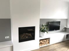 Woonhuis Oudorp - Lifs Lifs interieuradvies & styling www. Fireplace Tv Wall, Living Room With Fireplace, Bookshelves, Bookcase, Interior Design, Diy Interior, Family Room, Sweet Home, New Homes