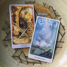 """12/27/15 - Two of Wands and High Priestess. The first card asks, """"Where can I find guidance in making tough decisions?""""  The High Priestess answers: """"Go deep within."""" Quiet the mind, step back from trying to force an answer to come through, and you will  gravitate towards one solution. Today's reading tells us, remember that your heart always knows what is right. (Haindl tarot deck)"""