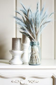 Dust your wheat with spray paint in the color of your choice to make a unique centerpiece. Group with candles.