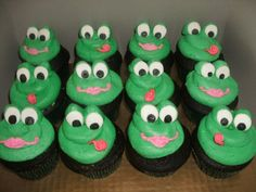 frog cupcakes - chocolate cupcakes filled with peanut butter cups, topped with peanut butter buttercream tinted green, to go with a frog theme birthday cake