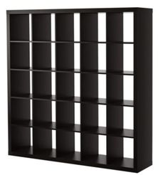Room divider between bed and couch.  73x73. May build on about a foot platform to raise and have more storage under it.  $199 Ikea.