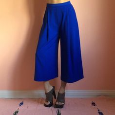 The Fifth Cobalt Cropped Trouser Rock out in Yves Klein blue with these cropped cobalt trousers from The Fifth. Features a high waist, pockets, wide leg silhouette and cropped hem. Wear with crop or long layers up top. Fits like an XS/S. Marked size small. No returns allowed. Please ask all questions before buying. IG: [at] jacqueline.pak #thefifth The Fifth Pants Ankle & Cropped