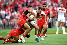 Canberra Raiders Elliott Whitehead of England is tackled during the 2017 Rugby League World Cup Semi Final match between Tonga and England at Mt Smart Stadium on November 25, 2017 in Auckland, New Zealand.