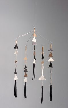 Leather triangle mobile. I love it SO MUCH.  I just ordered one for my office :)  It would be cute for a modern baby's crib or just as a pretty home decor!  Mine's going in my studio!