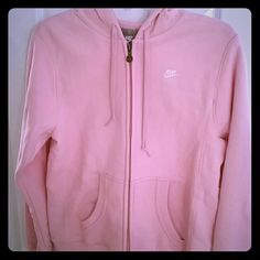 NWT Nike Pink Hoodie Never worn, perfect condition! Cute baby pink color and SO soft! Nike emblem on chest and zipper. Nike Tops Sweatshirts & Hoodies