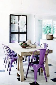 Eclectic kitchen with natural raw wood table and metal chairs in radiant orchid #coloroftheyear