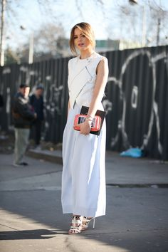 84 Outfit Ideas For Style Extroverts #refinery29  http://www.refinery29.com/2015/03/83675/paris-fashion-week-2015-street-style#slide-55  Zip up a vest over a gown for a tough-meets-pretty silhouette that really makes an impact.Kenzo top, pants, and clutch; Jimmy Choo shoes.