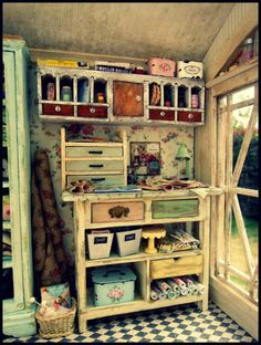 Wonderfully shabby craft room.