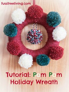 A Holiday / Christmas wreath made with pom poms.  Simple, speedy and super effective.