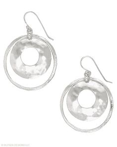 A hammered inner circle turns a typical Hoop into so much more. Sterling Silver. My most fav earrings ever!