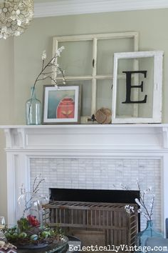 Love the way she propped windows, boat art from World Market and a rope monkey ball on the mantel for a relaxed nautical look eclecticallyvintage.com