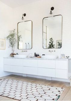 BECKI OWENS--Designer Spotlight: Alexander Design. Love this bathroom-- the floating vanity, marble counter, basin sinks, and brass details. See more on the blog.