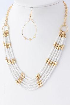 collar blanco/dorado